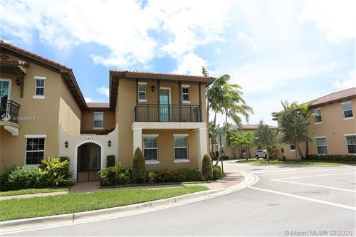 Photo of 1423 SW 147th Ave #1423, Pembroke Pines, FL 33027 (MLS # A10928576)