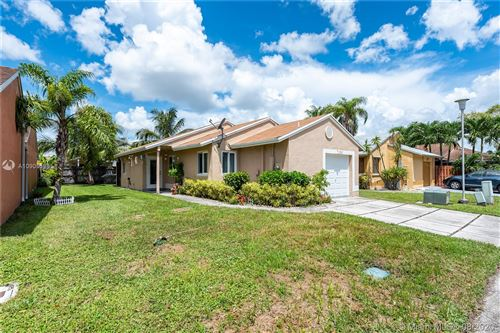 Photo of 1030 SW 111th Ave, Pembroke Pines, FL 33025 (MLS # A10905588)