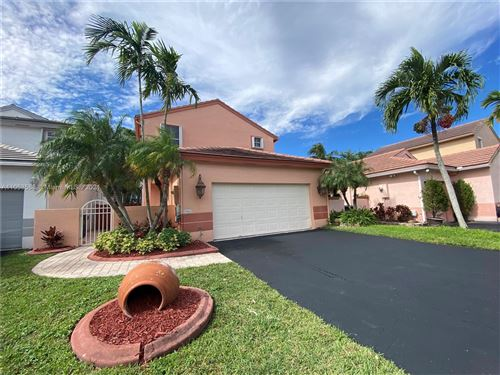Photo of 1960 NW 190th Ave, Pembroke Pines, FL 33029 (MLS # A11053588)