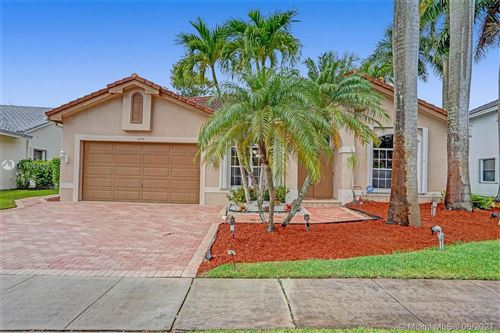 Photo of 1204 NW 180th Ave, Pembroke Pines, FL 33029 (MLS # A11055588)