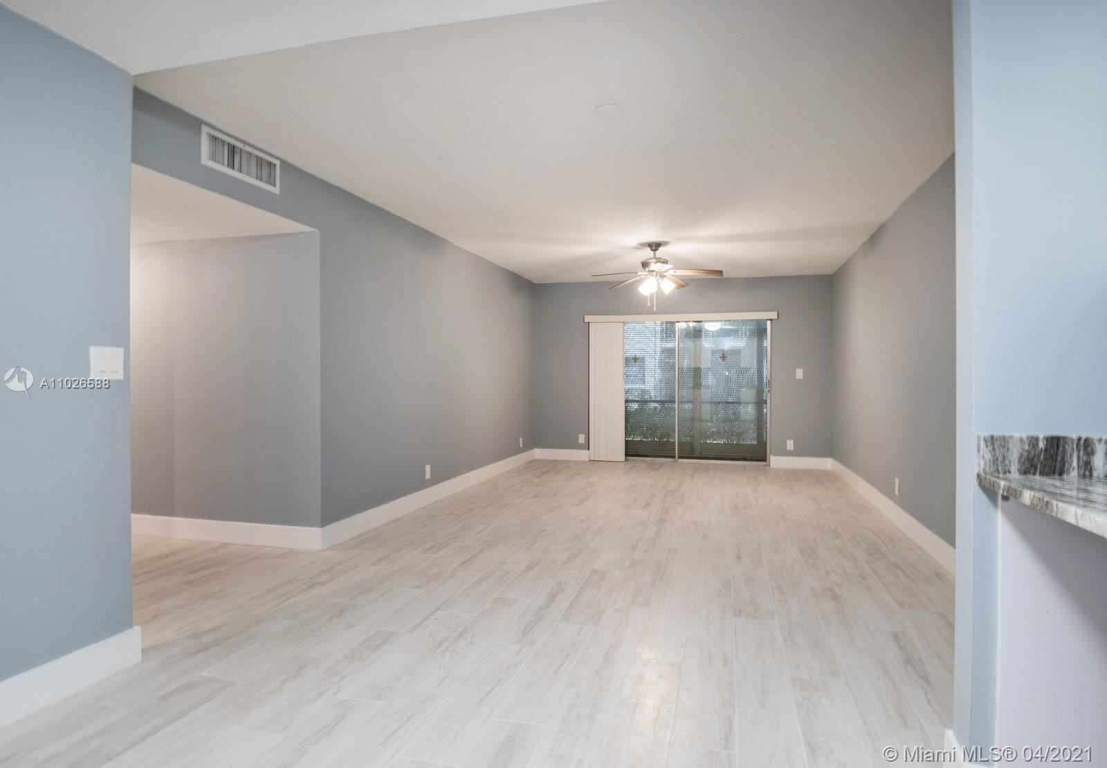 Photo of 4144 NW 90th Ave #104, Coral Springs, FL 33065 (MLS # A11026588)