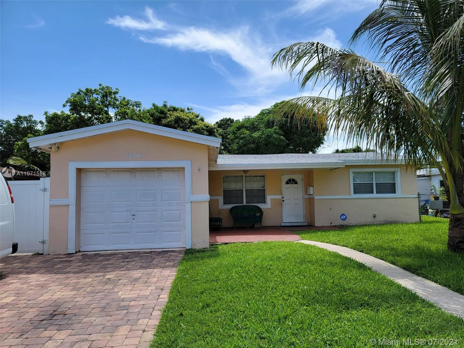 Photo of 3454 NW 33rd Ave, Lauderdale Lakes, FL 33309 (MLS # A11071588)