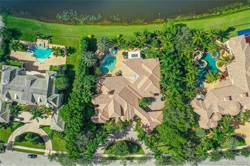 Photo of 2947 Lake Ridge Ln, Weston, FL 33332 (MLS # A10950591)