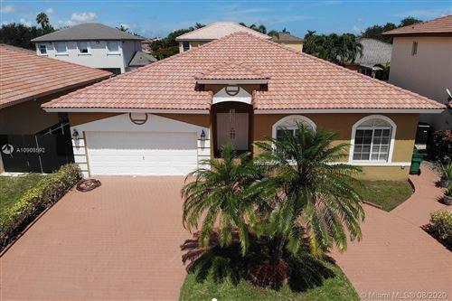 Photo of 14029 SW 160th Ct, Miami, FL 33196 (MLS # A10908592)