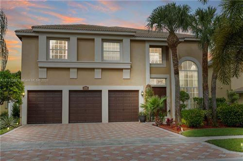 Photo of 2302 Ridgewood Cir, Royal Palm Beach, FL 33411 (MLS # A11117592)