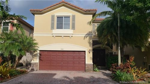 Photo of 4461 NW 112th Ct, Doral, FL 33178 (MLS # A10931594)
