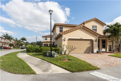 Photo of 10548 NW 36th St, Coral Springs, FL 33065 (MLS # A10837598)