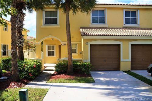 Photo of 16859 SW 1st Mnr #0, Pembroke Pines, FL 33027 (MLS # A10885598)