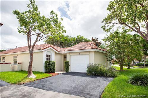 Photo of 1353 Garden Rd, Weston, FL 33326 (MLS # A10931598)