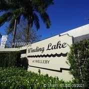 Photo of 10047 Winding Lake Rd #104, Sunrise, FL 33351 (MLS # A11098600)