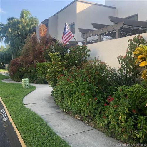 Photo of 4724 SW 67th Ave. #E-11, Miami, FL 33155 (MLS # A10931601)