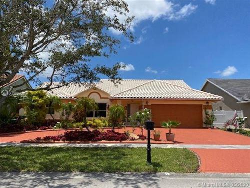 Photo of 16205 NW 14th St, Pembroke Pines, FL 33028 (MLS # A10864606)