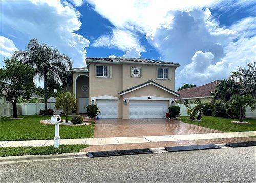 Photo of 875 SW 159th Ln, Pembroke Pines, FL 33027 (MLS # A11078606)