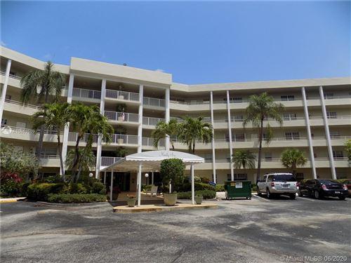 Photo of 805 Cypress Blvd #104, Pompano Beach, FL 33069 (MLS # A10869609)