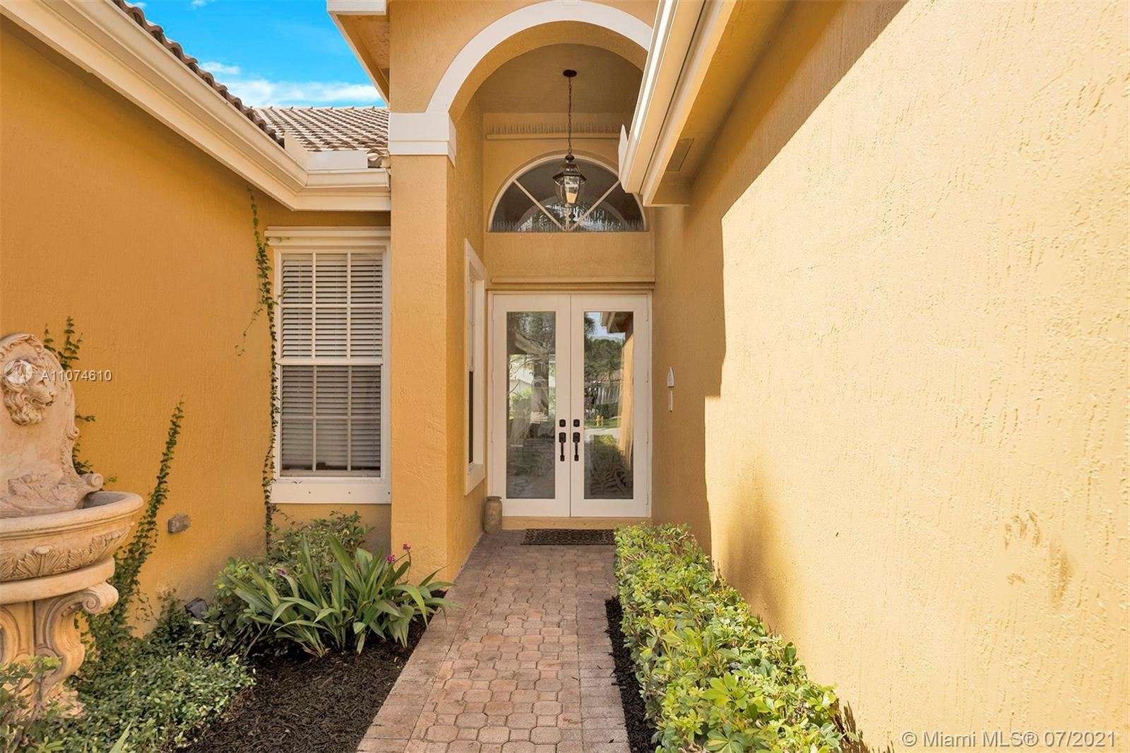 Photo of 12424 NW 62nd Ct, Coral Springs, FL 33076 (MLS # A11074610)