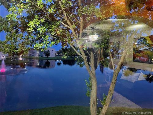 Photo of 9440 Sunrise Lakes Blvd #211, Sunrise, FL 33322 (MLS # A11101612)