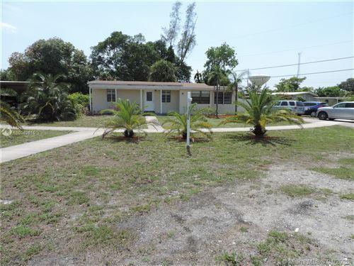 Photo of 1490 NE 51st St, Pompano Beach, FL 33064 (MLS # A10842615)