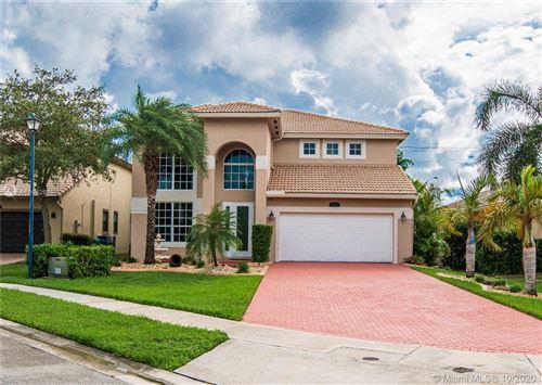 Photo of 14808 SW 54th St, Miramar, FL 33027 (MLS # A10942615)