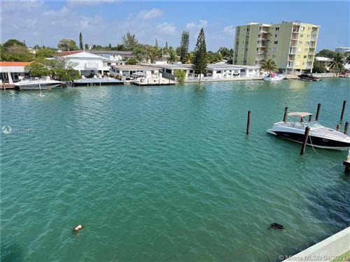 Photo of 7900 Tatum Waterway Dr #312, Miami Beach, FL 33141 (MLS # A11027616)