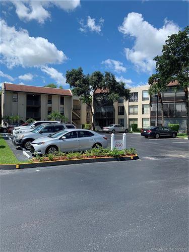 Photo of 7850 W Mcnab Rd #201, Tamarac, FL 33321 (MLS # A10883617)