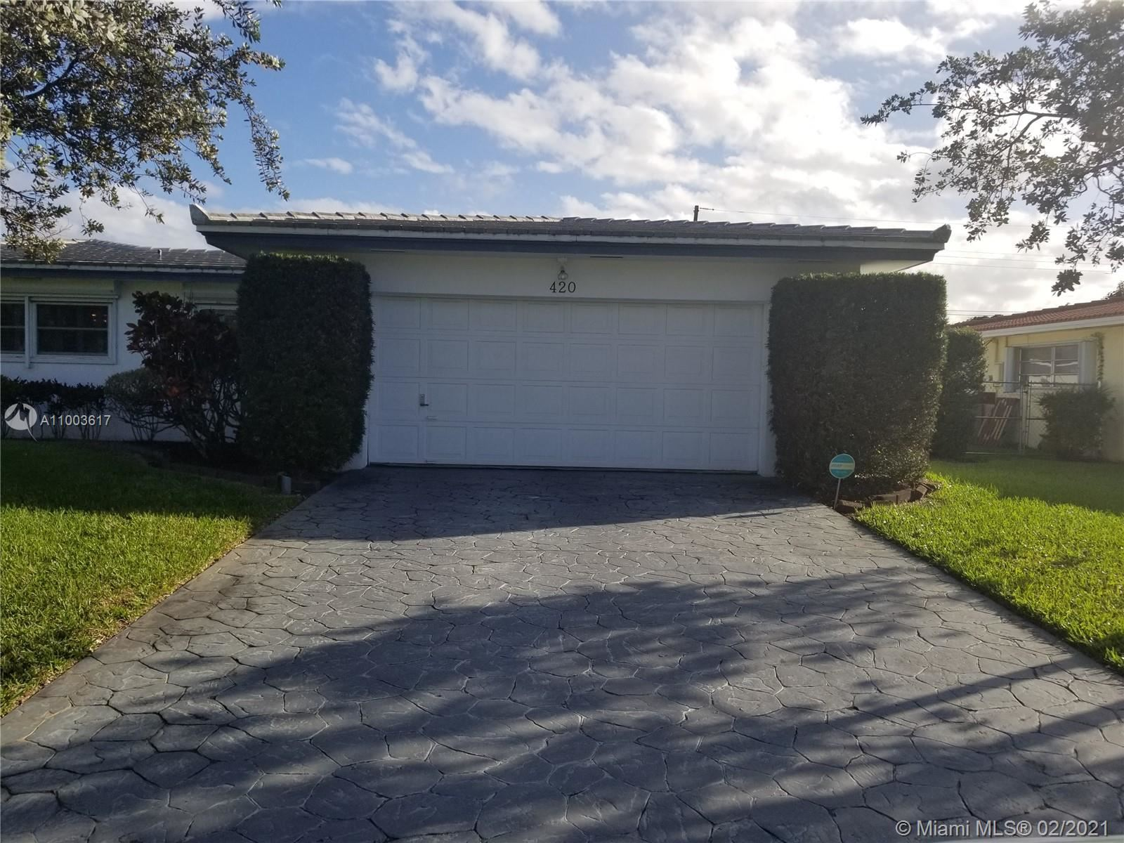 Photo of 420 N Highland Dr, Hollywood, FL 33021 (MLS # A11003617)