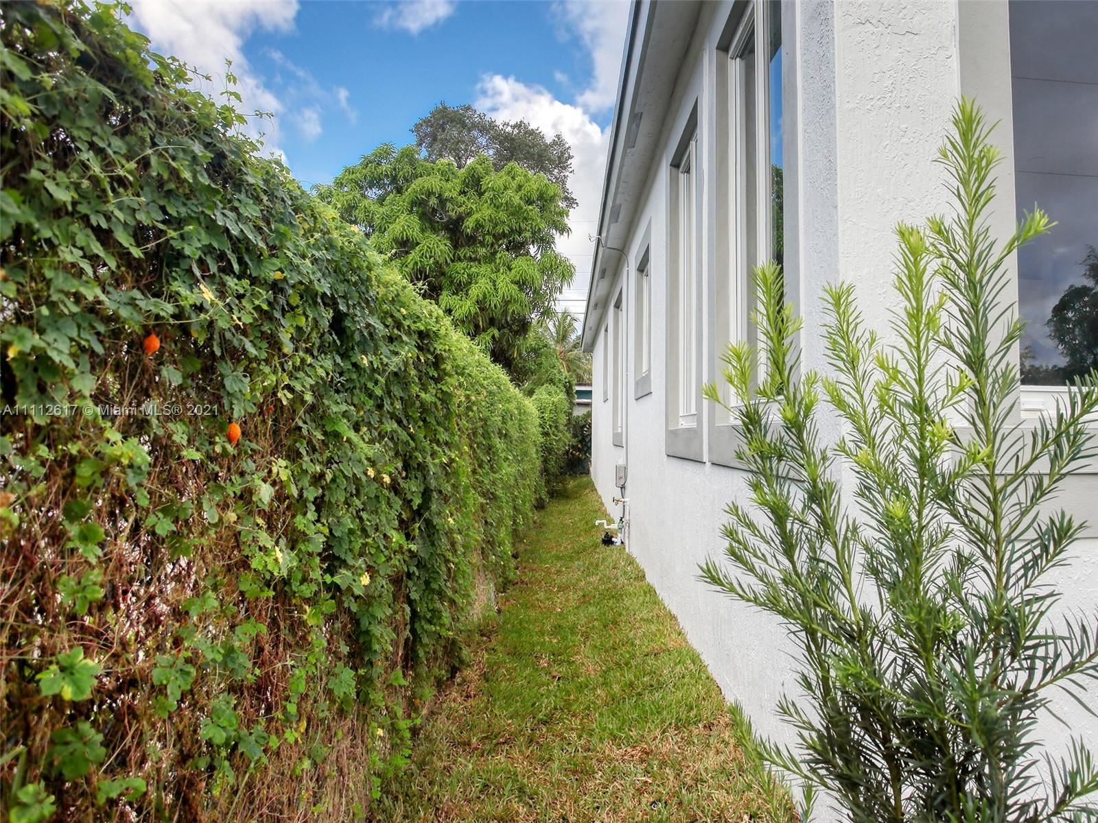 Photo of 881 NW 16th Ter, Fort Lauderdale, FL 33311 (MLS # A11112617)