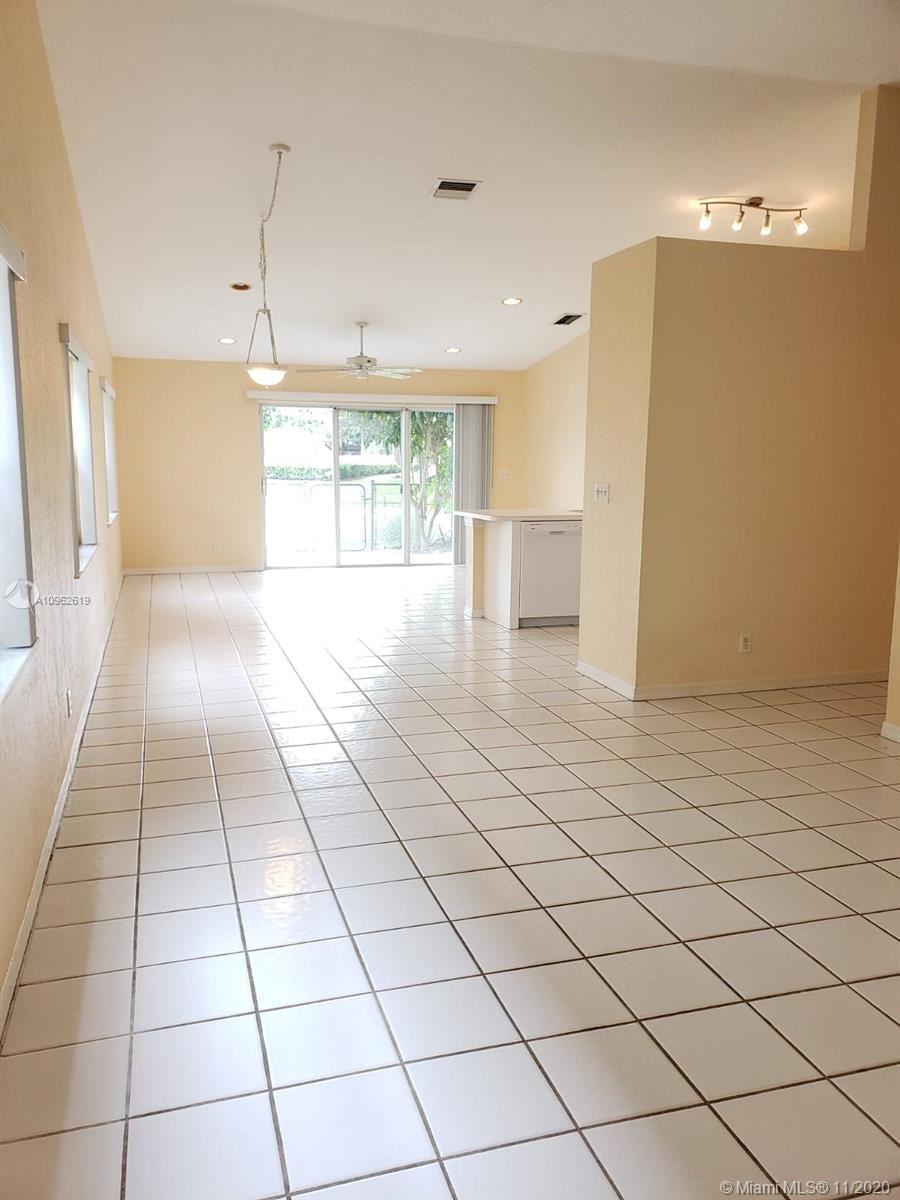 Photo of 4288 NW 1st Dr, Deerfield Beach, FL 33442 (MLS # A10962619)