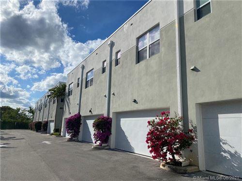 Photo of 405 NE 35th Ct #4, Oakland Park, FL 33334 (MLS # A11051620)
