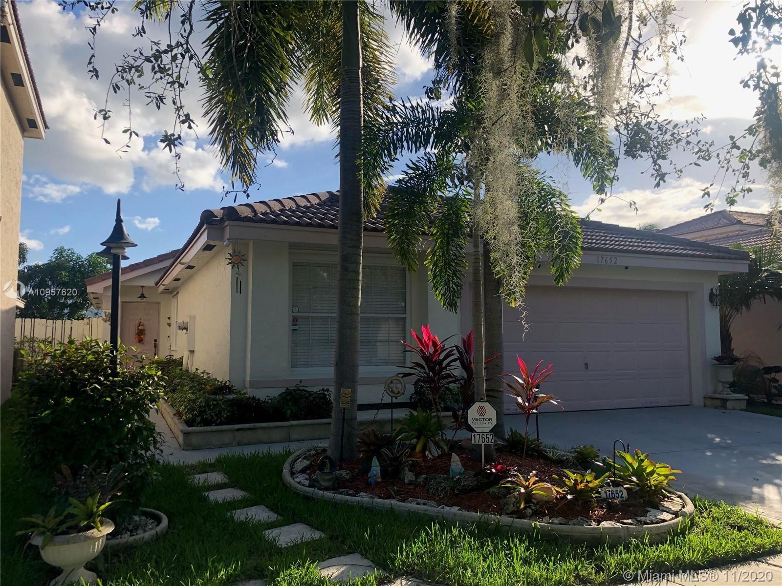 Photo of 17652 SW 18th St, Miramar, FL 33029 (MLS # A10957620)