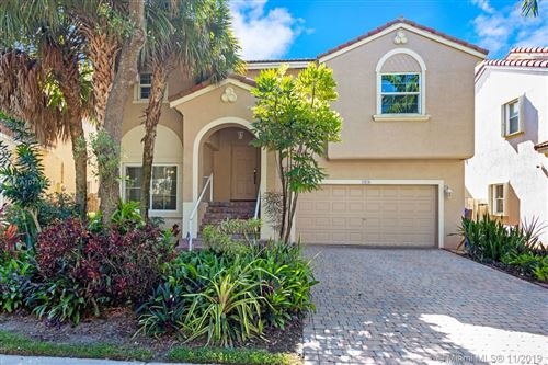 Photo of 7476 NW 18th Dr, Pembroke Pines, FL 33024 (MLS # A10774621)
