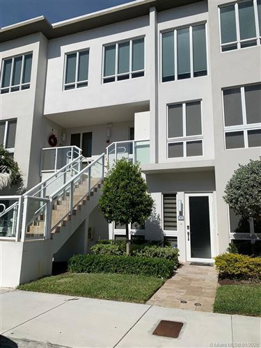 Photo of 10305 NW 63rd Ter #101, Doral, FL 33178 (MLS # A10799622)