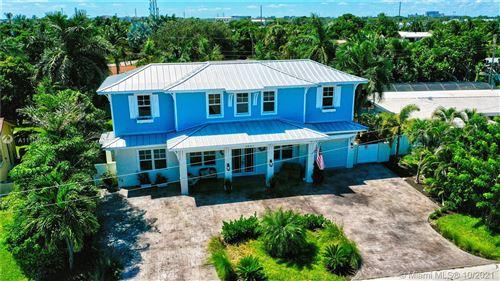 Photo of 2601 NE 26th Terrace, Boca Raton, FL 33431 (MLS # A11106624)
