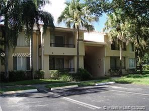 Photo of 831 Lyons Rd #23103, Coconut Creek, FL 33063 (MLS # A10836625)