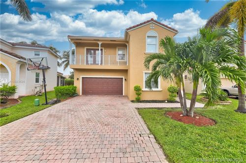 Photo of 734 NW 127th Ave, Coral Springs, FL 33071 (MLS # A10923626)