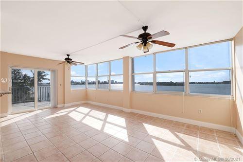 Photo of 11930 N Bayshore Dr #303, North Miami, FL 33181 (MLS # A11038626)