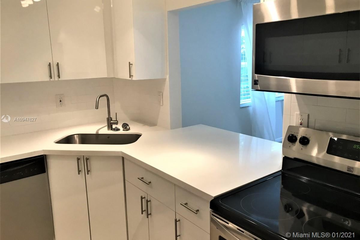 Photo of 619 Orton Ave #205, Fort Lauderdale, FL 33304 (MLS # A10947627)