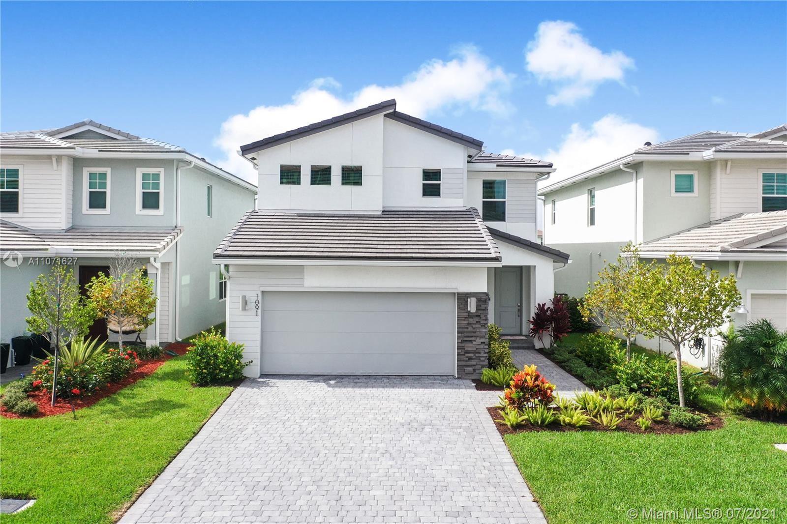 Photo of 1091 Veleiros Blvd, Deerfield Beach, FL 33064 (MLS # A11071627)