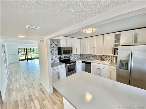 Photo of 370 Racquet Club Rd #106, Weston, FL 33326 (MLS # A10961628)