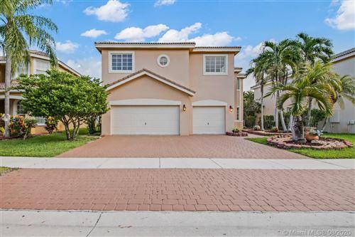 Photo of 16297 SW 15th St, Pembroke Pines, FL 33027 (MLS # A10906630)