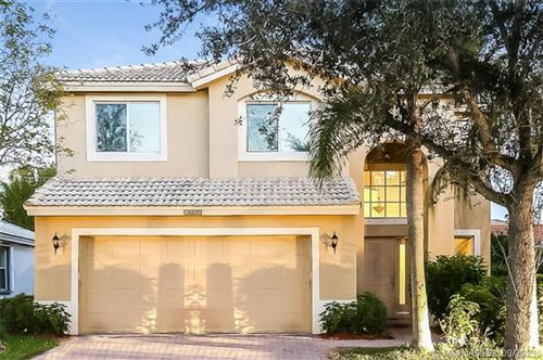 Photo of 5141 NW 122nd Ave, Coral Springs, FL 33076 (MLS # A11097630)