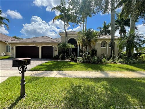 Photo of 1221 NW 137th Ave, Pembroke Pines, FL 33028 (MLS # A11106631)