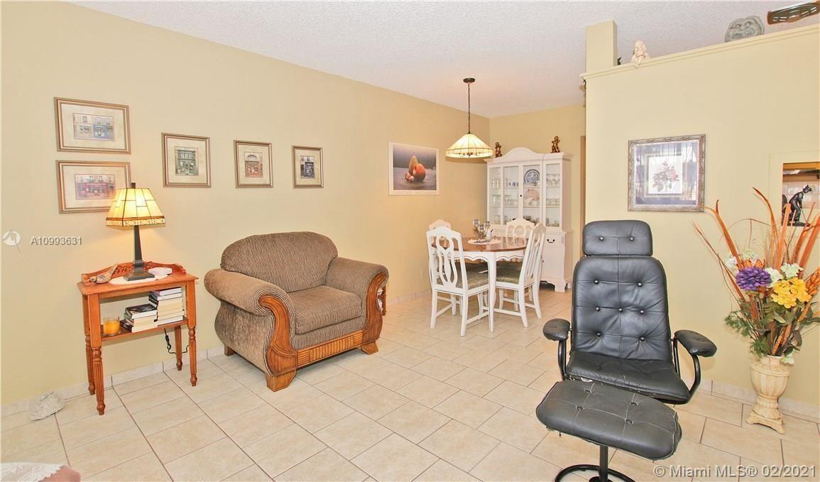 Photo of 900 SW 11th Ave #12A, Hallandale Beach, FL 33009 (MLS # A10993631)