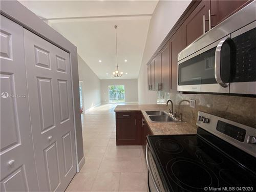 Photo of 7435 NW 33rd St, Lauderhill, FL 33319 (MLS # A10843632)