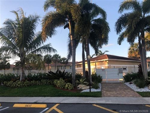 Photo of 900 Twin Lakes Dr #8-A, Coral Springs, FL 33071 (MLS # A10837633)
