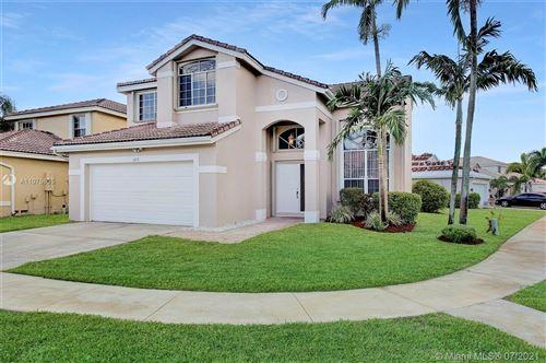 Photo of 1302 SW 178th Way, Pembroke Pines, FL 33029 (MLS # A11075635)