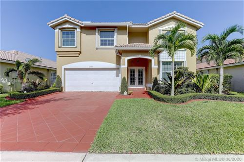 Photo of 2365 NW 137th Ave, Sunrise, FL 33323 (MLS # A10901636)