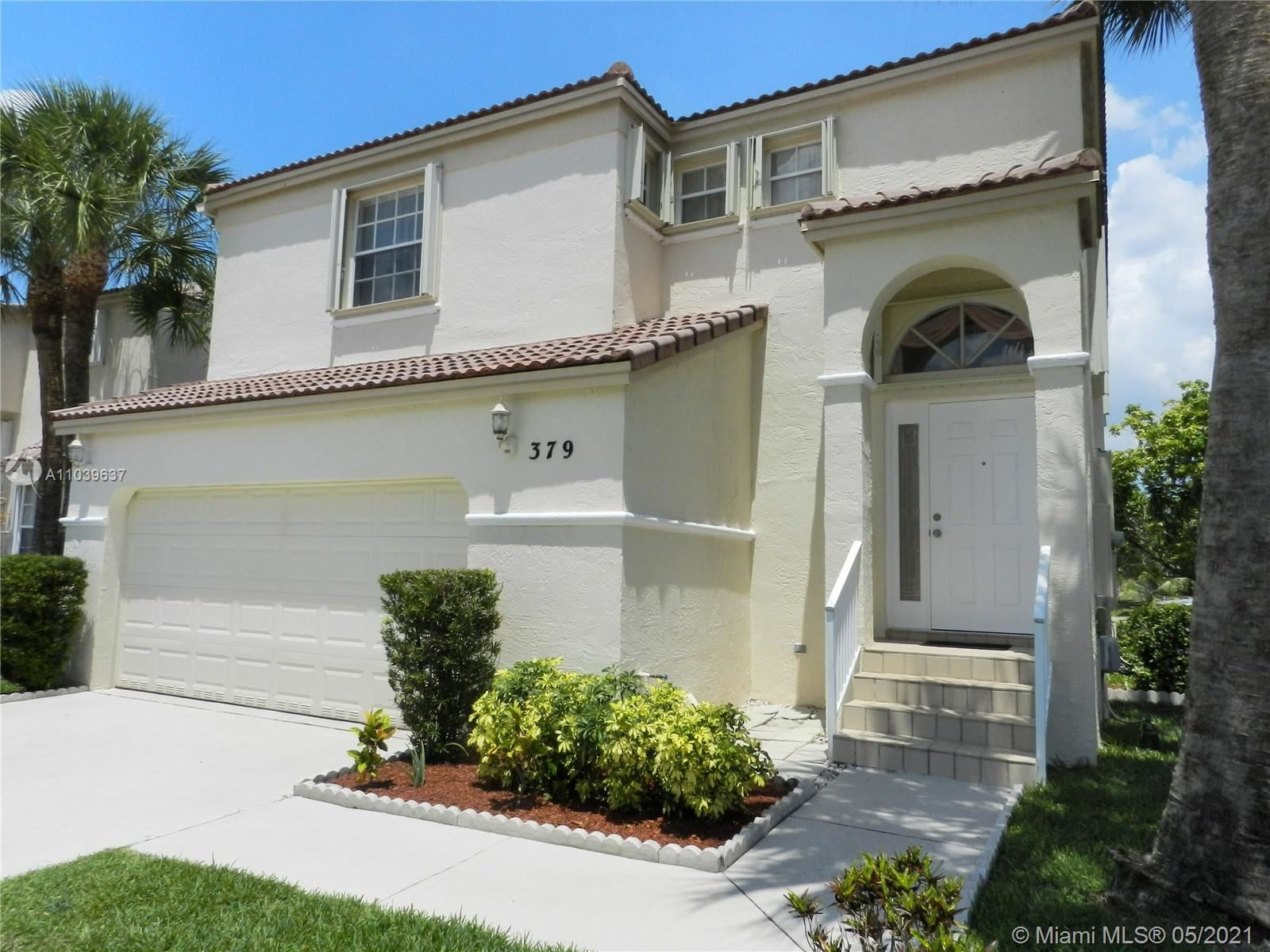 Photo of 379 NW 153rd Ave, Pembroke Pines, FL 33028 (MLS # A11039637)