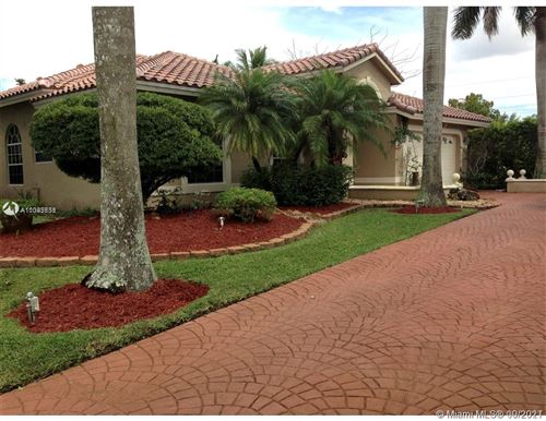 Photo of 12284 SW 1st St, Coral Springs, FL 33071 (MLS # A11092638)