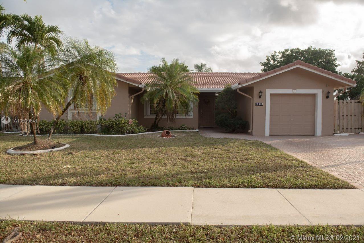 Photo of 11328 SW 59th St, Cooper City, FL 33330 (MLS # A10999641)