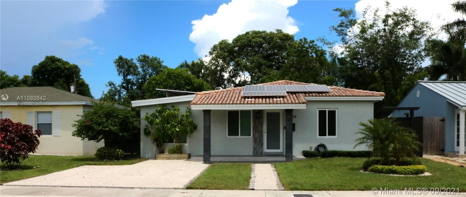 Photo of 1404 NE 1st Ave, Fort Lauderdale, FL 33304 (MLS # A11080642)